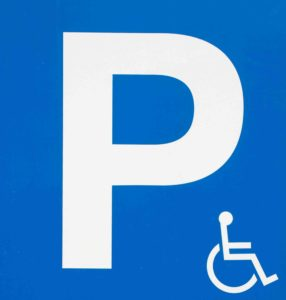 blue handicap parking sign with wheelchair symbol